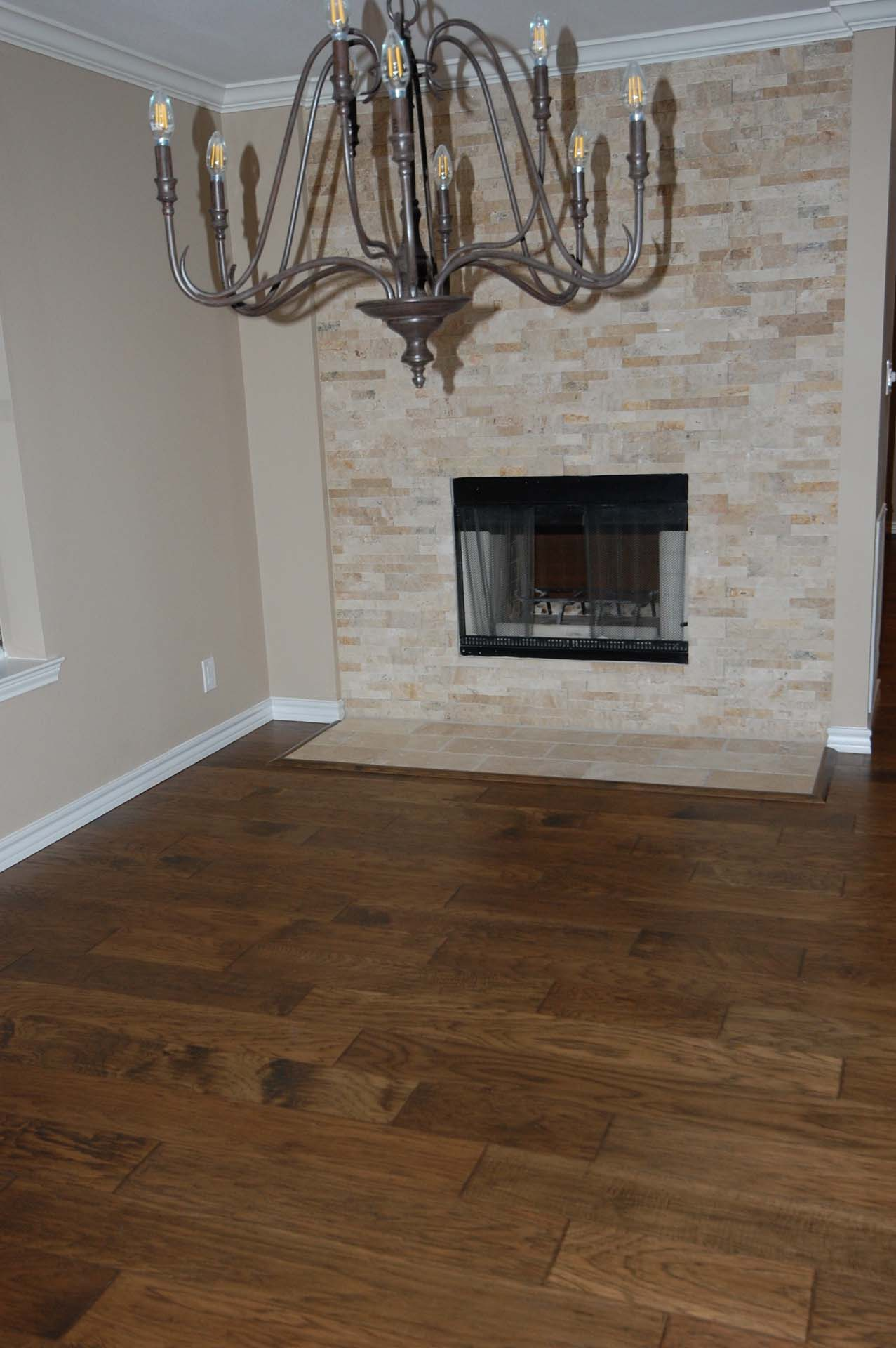 23 Dining Rm Stack Stone Fireplace wood floor