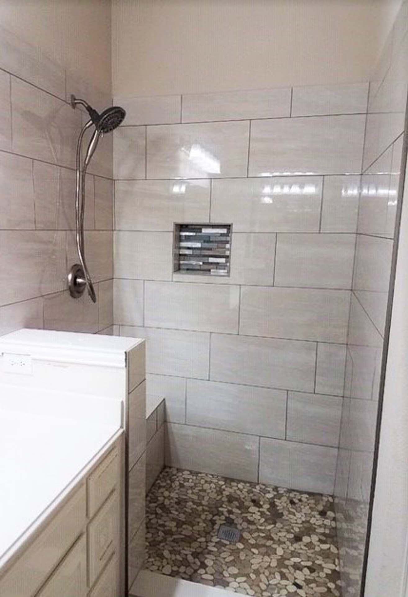 JH Pebblestone floor W Lg Format Staggered Shower Wall Tiles