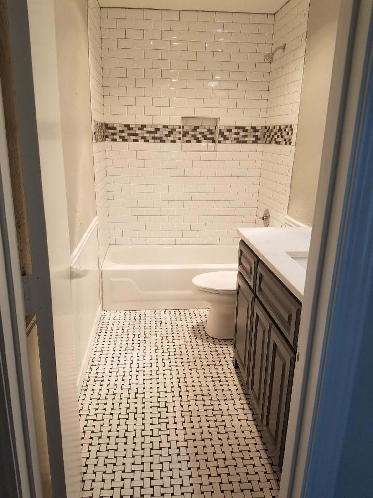 Mosaic floor and tub surround